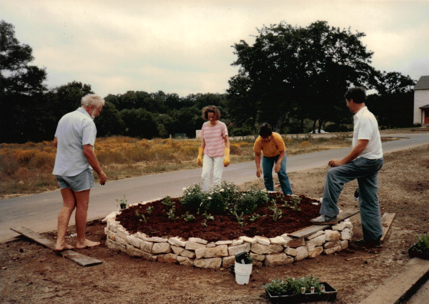 Planting the median at Royal Way & Sage Court. Looking Southeast. L-R: Keith Meyers Sr, Christiane Thompson, (unidentified), Robert Shaw
