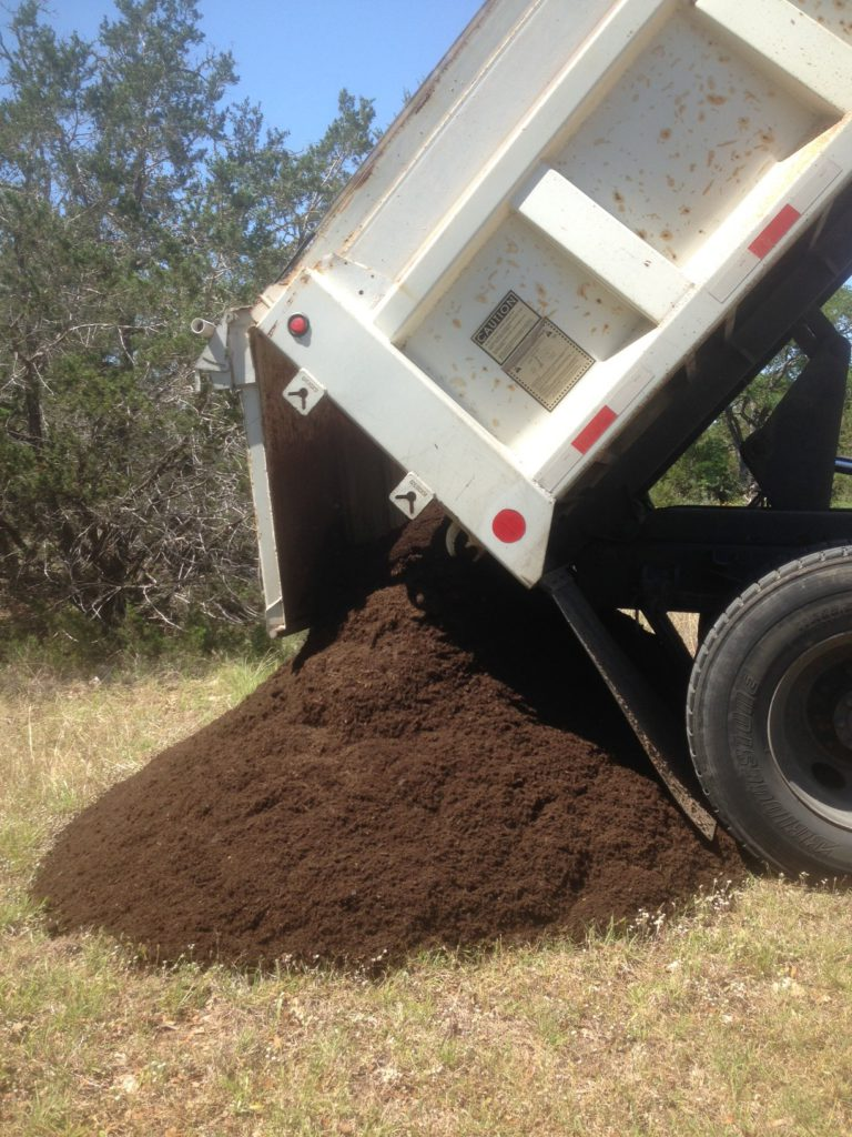 This is what five cubic yards of compost looks like. Yes, in our part of Hays County it is necessary to buy our own soil. The live oak trees are going to benefit in a big way here.
